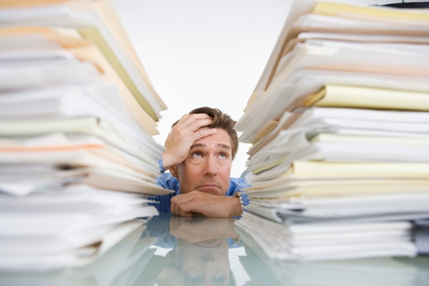 Businessman Overwhelmed with Paperwork