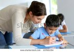 stock-photo-teacher-helping-young-boy-with-writing-lesson-107801354